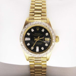 Gold and Diamond Rolex with Black Oyster Face